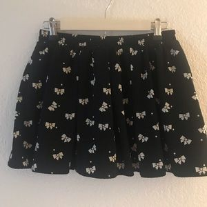 Black skirt with white bows